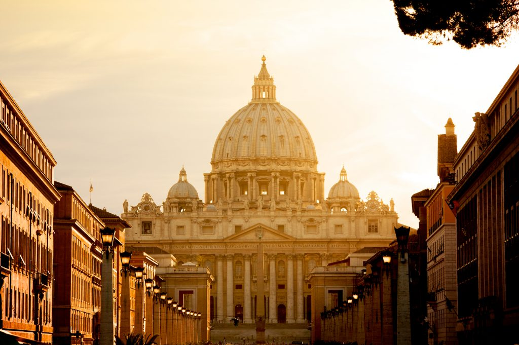 Vatican City, Vatican City State - August 21, 2008: St. Peter's Basilica at sunset from Via della Conciliazione. Vatican City State. Rome, Italy.