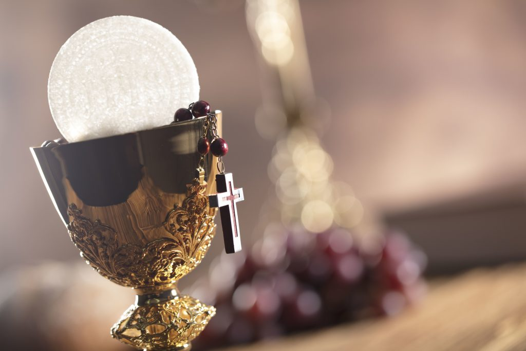 Catholic theme. Chalice, altar cross, bread and grapes.